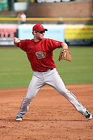 Matt Davidson #39 of the Arizona Diamondbacks fields a ground ball against the San Francisco Giants in the first spring training game of the season at Scottsdale Stadium on February 25, 2011  in Scottsdale, Arizona. .Photo by:  Bill Mitchell/Four Seam Images.
