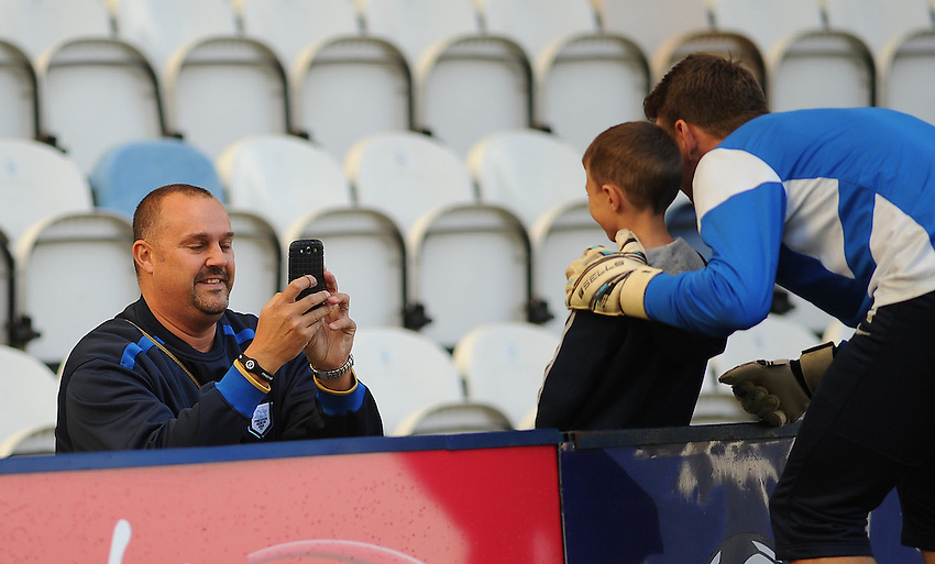 A father photographs his son with Preston North End's Jamie Jones during the pre-match warm-up <br /> <br /> Photographer Kevin Barnes/CameraSport<br /> <br /> Football - The Football League Sky Bet League One - Preston North End v Colchester United - Saturday 04th October 2014 - Deepdale - Preston<br /> <br /> &copy; CameraSport - 43 Linden Ave. Countesthorpe. Leicester. England. LE8 5PG - Tel: +44 (0) 116 277 4147 - admin@camerasport.com - www.camerasport.com