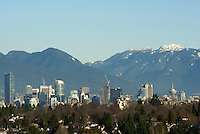 Vancouver skyline in winter with snow on the North Shore Mountains, Vancouver, Canada..