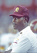 Washington Redskins wide receivers coach Charley Taylor watches from the sideline during a pre-season game against the Miami Dolphins at RFK Stadium in Washington, D.C. on August 25, 1989.  Taylor was inducted into the NFL Hall of Fame in 1984.  He played his entire career with the Redskins.  The Redskins won the game 35 - 21.  <br /> Credit: Arnold Sachs / CNP