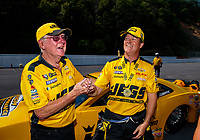 Jun 17, 2018; Bristol, TN, USA; NHRA pro stock driver Jeg Coughlin Jr (right) celebrates with father Jeg Coughlin Sr after winning the Thunder Valley Nationals at Bristol Dragway. Mandatory Credit: Mark J. Rebilas-USA TODAY Sports