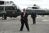 Security detail guard stands near Marine One (on left) carrying United States President Barack Obama and First Lady Michelle Obama before its departure from the Downtown Manhattan/Wall Street Heliport towards JFK Airport in New York New York, on September 29, 2015. <br /> Credit: Anthony Behar / Pool via CNP
