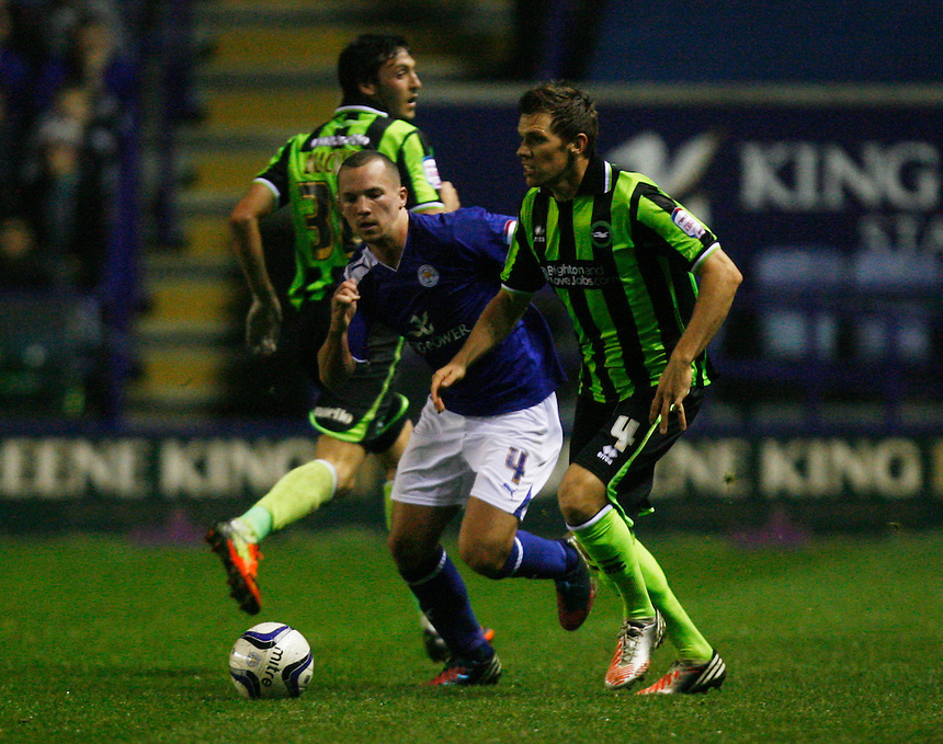 Brighton and Hove Albion's Dean Hammond and Leicester City's Daniel Drinkwater (C) in action during todays match        ..Football - npower Football League Championship - Leicester City v Brighton and Hove Albion - Tuesday 23rd October 2012 - King Power Stadium - Leicester..