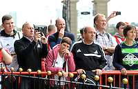 Swansea City fans watch their team bus arrive during the Barclays Premier League match between Sunderland and Swansea City played at Stadium of Light, Sunderland