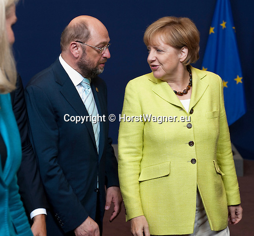 Brussels, Belgium -- July 16, 2014 -- European Council, EU-summit, meeting of Heads of State / Government to decide on the agenda and the composition of the new EU-Commission; here, Martin SCHULZ (le), President of the European Parliament, with Angela MERKEL (ri), Federal Chancellor of Germany -- Photo: © HorstWagner.eu