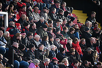 Lincoln City fans watch their team in action<br /> <br /> Photographer Chris Vaughan/CameraSport<br /> <br /> The EFL Sky Bet League Two - Lincoln City v Mansfield Town - Saturday 24th November 2018 - Sincil Bank - Lincoln<br /> <br /> World Copyright &copy; 2018 CameraSport. All rights reserved. 43 Linden Ave. Countesthorpe. Leicester. England. LE8 5PG - Tel: +44 (0) 116 277 4147 - admin@camerasport.com - www.camerasport.com