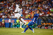 04.06.2014. Frisco, Texas, USA.  Ivory Coast midfielder Cheik Ismael Tiote (9) takes a shot during the international soccer friendly between the Ivory Coast and El Salvador National teams played at Toyota Stadium in Frisco, TX.  Ivory Coast defeated El Salvador 2-1.
