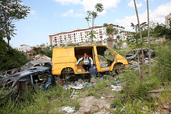 The team stops again in an area where many of Tirana's trans-sexual prostitutes live in on the fringes of society in abandoned or burnt out cars. <br />