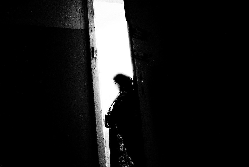 An Iraqi woman from Baghdad stands in the doorway of her home in Amman, Jordan, September 2009. Photo: Ed Giles,