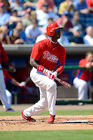 Philadelphia Phillies outfielder Domonic Brown #9 during a Spring Training game against the Dominican Republic at Bright House Field on March 5, 2013 in Clearwater, Florida.  The Dominican defeated Philadelphia 15-2.  (Mike Janes/Four Seam Images)
