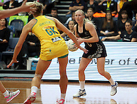 13.10.2013 Silver Fern Laura Langman in action during the Silver Ferns V Australian Diamonds Netball Series played at the AIS Arena in Canberra Australia. Mandatory Photo Credit ©Michael Bradley.