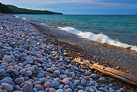 Rocks and driftwood on Pebble Beach. Lake Superior. <br />