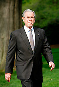 United States President George W. Bush arrives to make a statement on the economic stimulus rebate checks as he prepares to depart the White House in Washington, DC on April 25, 2008.  The President will travel to Connecticut.<br /> Credit: Aude Guerrucci / Pool via CNP