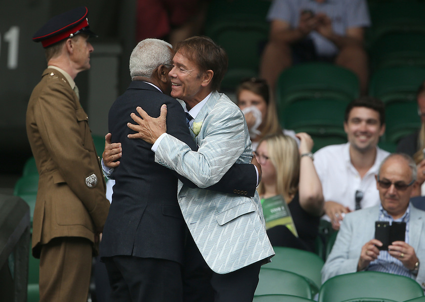 Cliff Richard and Sir Trevor McDonald, OBE greet each other in the members enclosure<br /> <br /> Photographer Stephen White/CameraSport<br /> <br /> Tennis - Wimbledon Lawn Tennis Championships - Day 2 - Tuesday 28th June 2016 -  All England Lawn Tennis and Croquet Club - Wimbledon - London - England<br /> <br /> World Copyright &copy; 2016 CameraSport. All rights reserved. 43 Linden Ave. Countesthorpe. Leicester. England. LE8 5PG - Tel: +44 (0) 116 277 4147 - admin@camerasport.com - www.camerasport.com