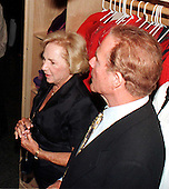 In this file photo dated April 21, 1998, Frank Gifford, right, and Ethel Kennedy, left, tour the controversial new exhibit on sweatshops at the Smithsonian Museum of American History in Washington, D.C.  Gifford's family announced he passed away on Sunday, August 9, 2015.<br /> Credit: Ron Sachs / CNP