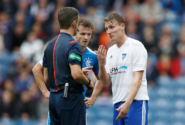 Referee Greg Aitken has words with Rory McAllister and Andy Halliday after the players clashed on the touchline
