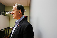 Former Pennsylvania senator and Republican presidential candidate Rick Santorum waits to be introduced before a town hall at the Concord office of New England College in Concord, New Hampshire.