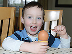 Oisín McKenna grandson of Lynn McDonnell Oulster Lane pictured with the enormous egg laid by one of her hens. Photo:Colin Bell/pressphotos.ie