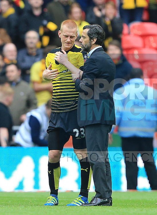 Watford's Ben Watson gets consled by manager Quique Flores at the final whistle of the Emirates FA Cup, Semi-Final match at Wembley Stadium, London.  Photo credit should read: David Klein/Sportimage