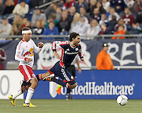 New England Revolution substitute midfielder Juan Toja (18) is tripped up. Despite a red-card man advantage, in a Major League Soccer (MLS) match, the New England Revolution tied New York Red Bulls, 1-1, at Gillette Stadium on September 22, 2012.