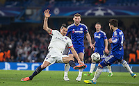 Zlatan Ibrahimovic of Paris Saint-Germain beats Cesc Fabregas of Chelsea to the ball during the UEFA Champions League Round of 16 2nd leg match between Chelsea and PSG at Stamford Bridge, London, England on 9 March 2016. Photo by Andy Rowland.