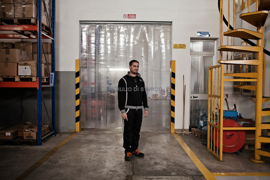 Indian people work at the Tecom factory in Novellara, October 22, 2010..Novellara, a city of  almost 14 thousand inhabitants, 18% are foreigners and they belong to 50 different countries, with China in the lead, followed by Indians,Pakistani, North Africans and Eastern European nationals. In School immigrants or children of immigrants are more than 40% of the students..
