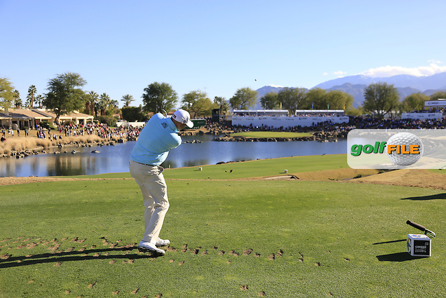 Bill Haas (USA) tees off the par3 17th tee during Saturday's Round 3 of the 2017 CareerBuilder Challenge held at PGA West, La Quinta, Palm Springs, California, USA.<br /> 21st January 2017.<br /> Picture: Eoin Clarke | Golffile<br /> <br /> <br /> All photos usage must carry mandatory copyright credit (&copy; Golffile | Eoin Clarke)