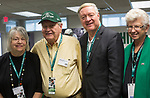 President Duane Nellis and Ruthie Nellis pose with Lily Dickens and William Dickens, a '62 OU alumnus, on Sept. 2, 2017 in the Presidents box at Peden Stadium.