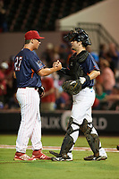 Clearwater Threshers pitcher Jeff Singer (27) and Daytona Tortugas catcher Chris Okey (39) shake hands after closing out the Florida State League All-Star Game on June 17, 2017 at Joker Marchant Stadium in Lakeland, Florida.  FSL North All-Stars  defeated the FSL South All-Stars  5-2.  (Mike Janes/Four Seam Images)