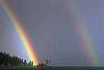 "Double Rainbow striking shoreline during rain storm Coeur D"" Alene, Idaho State USA"