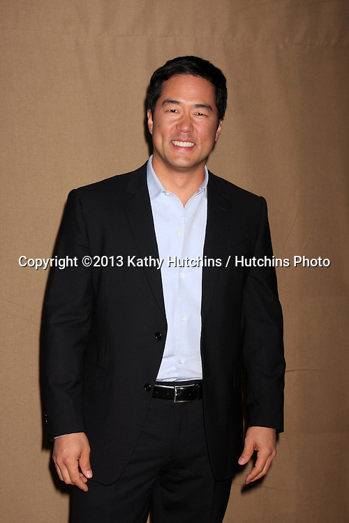 LOS ANGELES - JUL 29:  Tim Kang arrives at the 2013 CBS TCA Summer Party at the private location on July 29, 2013 in Beverly Hills, CA
