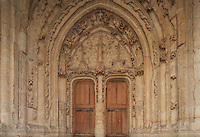 Sculpted tympanum and vaults above the right entrance door of the South East portal, Collegiale Notre-Dame de Poissy, a catholic parish church founded c. 1016 by Robert the Pious and rebuilt 1130-60 in late Romanesque and early Gothic styles, Poissy, Yvelines, France. The wooden door was sculpted in 1540, and the whole entrance was restored 1999-2000. The Collegiate Church of Our Lady of Poissy was listed as a Historic Monument in 1840 and has been restored by Eugene Viollet-le-Duc. Picture by Manuel Cohen