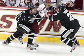 Tim Schaller (Providence - 11), Quinn Smith (BC - 27), Steven Shamanski (PC - 28) - The Boston College Eagles defeated the visiting Providence College Friars 4-1 (EN) on Tuesday, December 6, 2011, at Kelley Rink in Conte Forum in Chestnut Hill, Massachusetts.