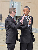United States Department of Energy HQ Energy Manager Eric Haukdal, left, explains the workings of the rooftop solar panels to U.S. President Barack Obama, right, at the U.S. Department of Energy in Washington, D.C. on Thursday, March 19, 2015.  <br /> Credit: Ron Sachs / Pool via CNP