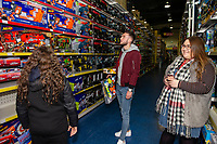 Pictured: Matt Grimes of Swansea City buying children gifts at Smyth's Toy Store, in Swansea, Wales, UK. Wednesday 19 December 2018