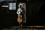 Bluegrass pioneer George Shuffler, 82, poses for a portrait near a storage barn behind his home in Valdese, NC.