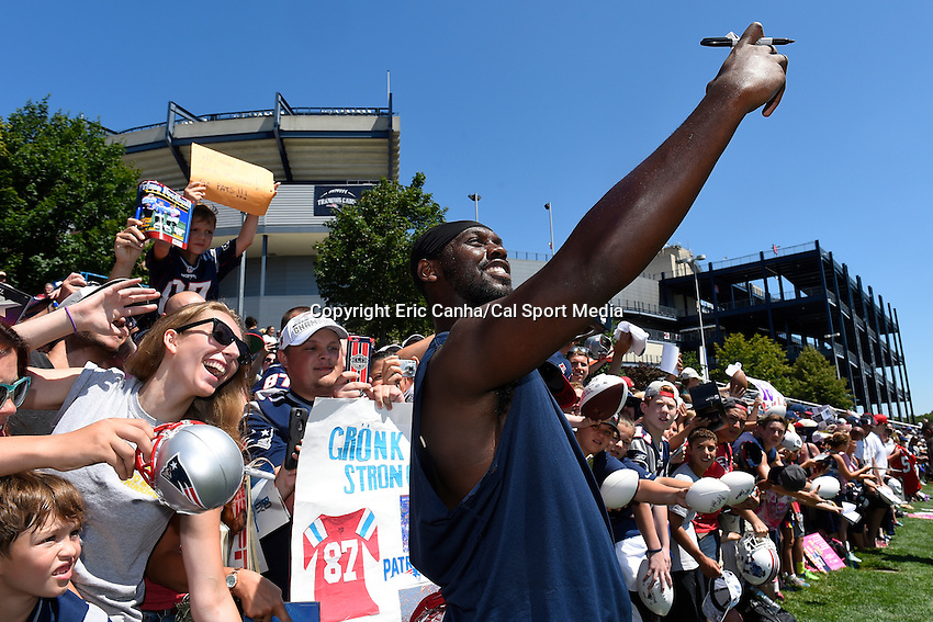 August 2, 2015, Foxborough, MA - New England Patriots defensive end Chandler Jones (95) takes a selfie with a fan  during the New England Patriots training camp held on the practice field at Gillette Stadium. Eric Canha/CSM
