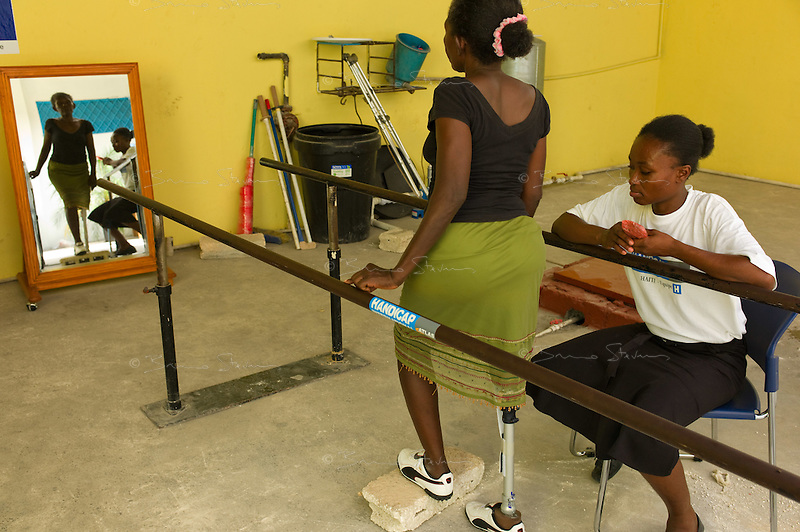 Port Au Prince, Haiti, April 19, 2010.Almène, 55 is trying her new prosthetic leg. Handicap International center; thousands of people have lost one or more limbs in the January 12 earthquake; the need for prosthetics and reeducation is enormous and will be long lasting as many victims are children who will need constant adjustments to their prothesis.