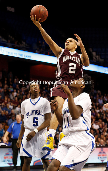 Uncasville, CT- 22 March 2015-032215CM02- Naugatuck's Jarron Chapman (2) goes to the hoop against Bunnell's Rashaad Spain (5) and Aaron Samuel during their first half matchup in the Class L state championship game at Mohegan Sun Arena in Uncasville on Sunday.    Christopher Massa Republican-American