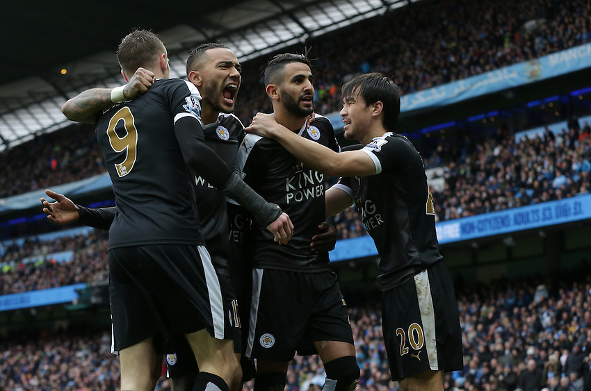 Leicester City's Riyad Mahrez (2nd from right) celebrates scoring his sides second goal with team-mates (left to right) Jamie Vardy, Danny Simpson and Shinji Okazaki<br /> <br /> Photographer Stephen White/CameraSport<br /> <br /> Football - Barclays Premiership - Manchester City v Leicester City - Saturday 6th February 2016 -  Etihad Stadium - Manchester<br /> <br /> &copy; CameraSport - 43 Linden Ave. Countesthorpe. Leicester. England. LE8 5PG - Tel: +44 (0) 116 277 4147 - admin@camerasport.com - www.camerasport.com