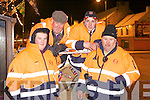 Members of the Abbeyfeale District Search and Rescue(ADSAR) busy in Abbeyfeale last Friday night installing street lighting for the festive season, pictured l-r: Richard, Michael, Declan and Christy Kelliher.