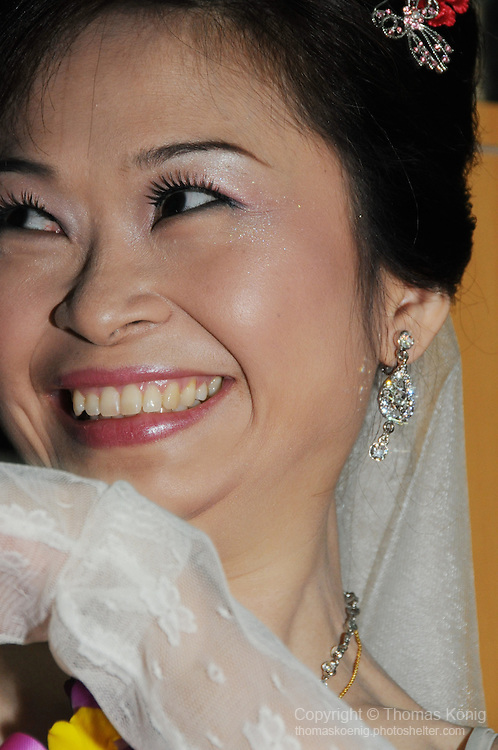 Taiwanese Wedding -- Bride smiling.