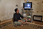 17/04/15. Goktapa, Iraq. Jasm watching a videoclip of the singer Kadhm Sahir<br /> He is a big fan of him and he hopes to meet him in person one day.