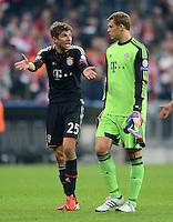 FUSSBALL   CHAMPIONS LEAGUE   SAISON 2012/2013   GRUPPENPHASE   FC Bayern Muenchen - FC Valencia                            19.09.2012 Thomas Mueller und Torwart Manuel Neuer (v. li., FC Bayern Muenchen)