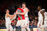 NEW YORK, NY - Sunday December 13, 2015: Amar Alibegovic (#1) of St. John's celebrates against Syracuse as the two square off during the NCAA men's basketball regular season at Madison Square Garden in New York City.  St. John's would go on to win 84-72.