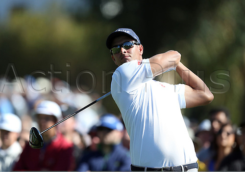 21.02.2016. Pacific Palisades, California, USA.  Adam Scott hits a tee shot during the fourth round of the Northern Trust Open at Riviera Country Club in Pacific Palisades, CA.