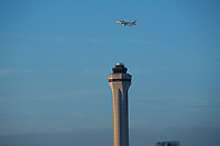 MIAMI FLORIDA - JANUARY  22: A plane pass over the Miami International Airport on January 22, 2020 in Miami, Florida. Miami is getting ready for Super Bowl as thousands of tourists descend on the state to celebrate the biggest sporting event of the year. (Photo by Kena Betancur / VIEWpress).