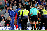 Chelsea's Assistant to First Team Coach, Paolo Vanoli, looks back in anger at referee Lee Mason as the Officials walk off at half-time with Chelsea stewards during Chelsea vs Huddersfield Town, Premier League Football at Stamford Bridge on 9th May 2018