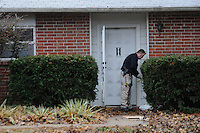 NWA Media/ J.T. Wampler - Rogers police crime scene technician Brian Culpepper works Thursday Dec. 18, 2014 at 2703 Highlands Dr. where police say Brent Wilks abducted 2-year-old Alex Gage Almodovar early Thursday Morning.