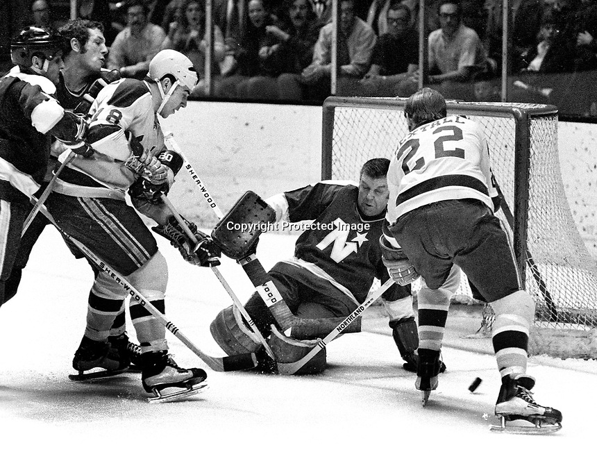 California Golden Seals attach North Star goalie Gump Worsley, Gary Croteau and Dennis Hextall ..(1971 photo/Ron Riesterer)